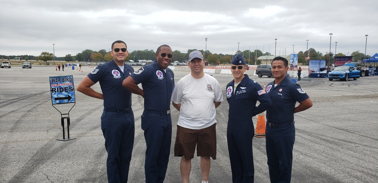 Post Youth and Programs Chairman Greg Doss with some of the Thunderbirds members at Atlanta Air Show.